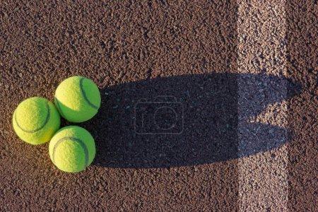Three tennis balls