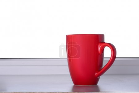 Red cup on the windowsill
