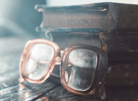 glasses with old books