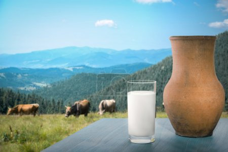 Milk on table with mountains
