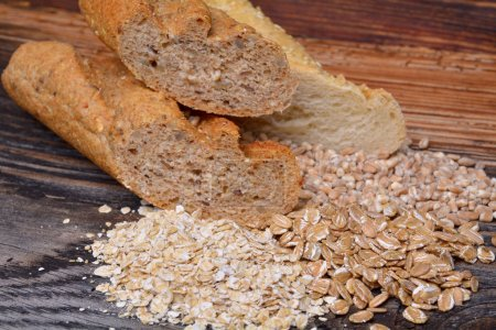 Bread and  grains on wooden background