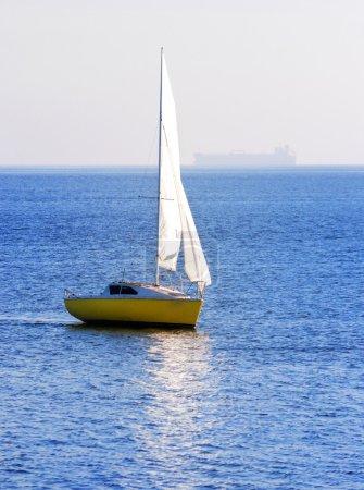 yellow sail yacht sailing