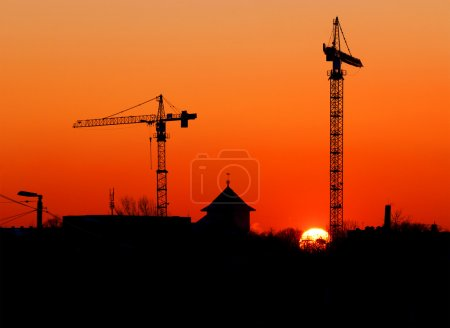 Cranes and other buildings silhouettes