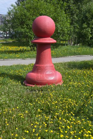 """Chess pieces - red pawn on the green grass in the park """"Taganskaya settlement."""" Ekaterinburg"""