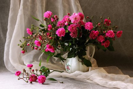 Bouquet of small roses in a vase.
