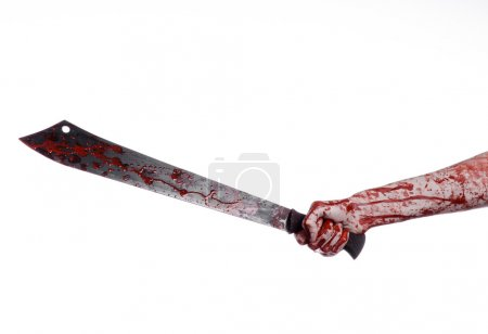 Halloween theme: hand holding a bloody machete on a white background