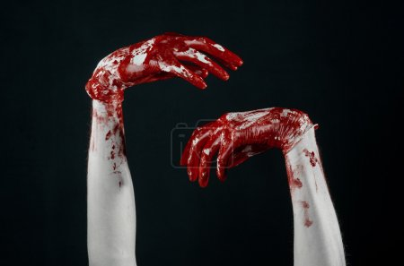Photo for Bloody hands in white gloves, a scalpel, a nail, black background, zombie, demon, maniac in studio - Royalty Free Image