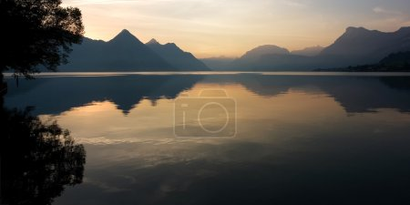 Photo for Lake reflection on a beautiful summer sunrise, in the Swiss Alps. Buochs, Switzerland. - Royalty Free Image