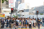 Tokyo ,Japan - May 25 ,2014. Many people cross the street and tr