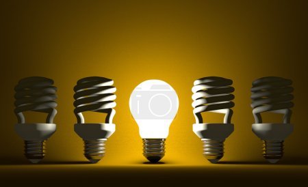 Glowing tungsten Light bulb among dead spiral ones