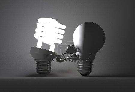 Foto de Brillante bombilla fluorescente punzonado apagado tungsteno uno con sus puños sobre fondo texturizado gris - Imagen libre de derechos
