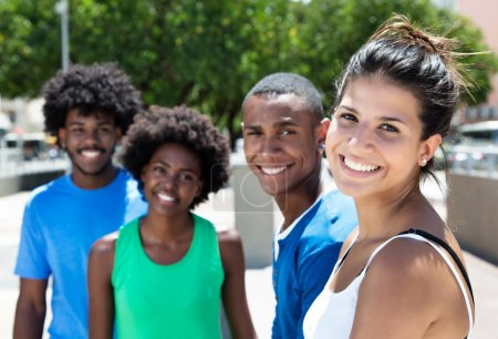 Beautiful young caucasian woman with african american friends in