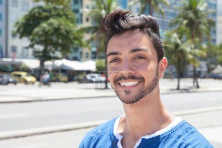 Dreaming brazilian guy in a modern city