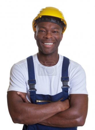 Laughing african construction worker with crossed arms