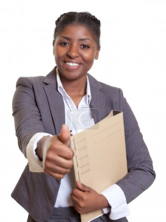 African business woman with file showing thumb up