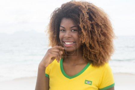 Happy brazilian girl with crazy hairstyle