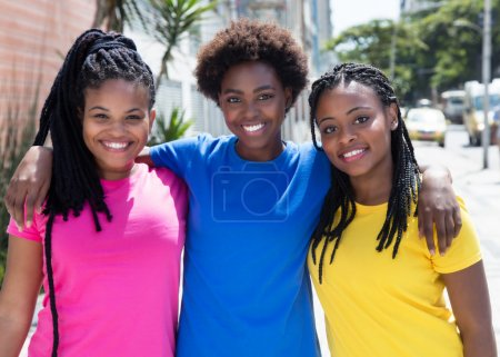 Three beautiful african american girlfriends in the city