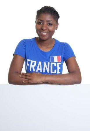 French soccer fan behind a whiteboard