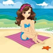 Brunette Girl Sitting On The Beach