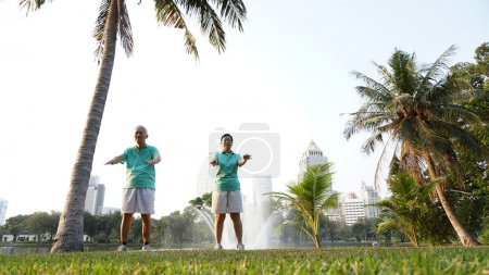 senior couple exercise in the urban park at early morning
