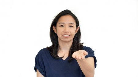 Asian girl doing presentation hand gesture with  copy space