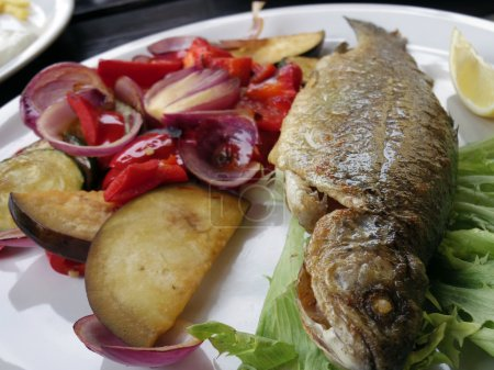 grill trout steak with vegetable