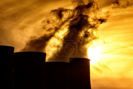 Electric power plant at dusk with orange sky in Kozani Greece
