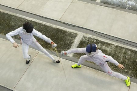 Young athletes competing during the World Youth Fencing Champion