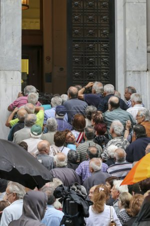 Pensioners queue outside a National Bank branch as banks only op