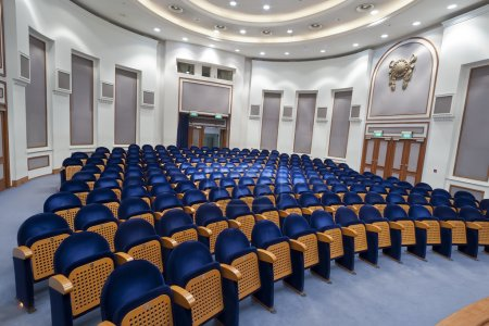 Empty blue seats for cinema, theater, conference or concert. The