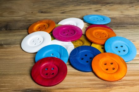 Colored buttons on wooden board, Colorful buttons, on old wooden
