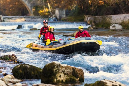 adventurous group doing white water rafting the rapids of river