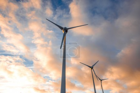 Electric windmills on the sky background