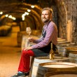 Постер, плакат: Portrait of a sommelier in the wine cellar