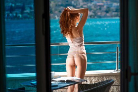 Young and pretty woman on the balcony