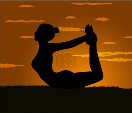 Girl makes yoga exercise at the gloaming