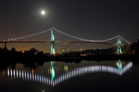 Photo for Vancouver, Canada. Spectacular view of Lions Gate Bridge in a full moon. Beautiful panorama gives a special feeling of modern technologies and beauty. - Royalty Free Image