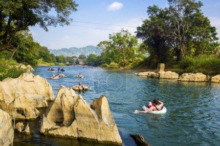 Tourists Tubing Down Song River at Vang Vieng, Laos