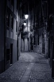 Old european alley by night