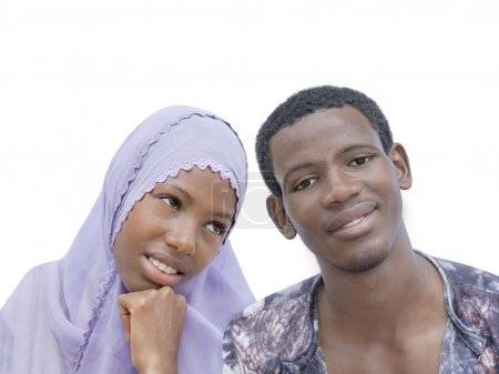 Young couple showing a beautiful complicity, isolated