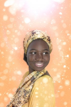 Young Afro girl smiling in a magical atmosphere