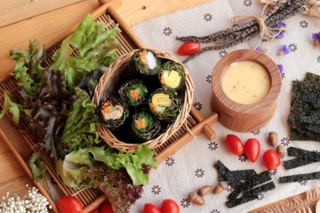 Photo for Vegetable salad wrapped with seaweed into spring rolls - Royalty Free Image
