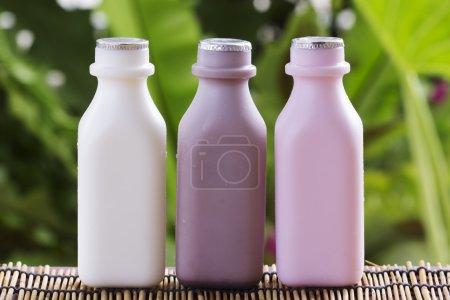 Strawberry, chocolate and fresh milk bottles