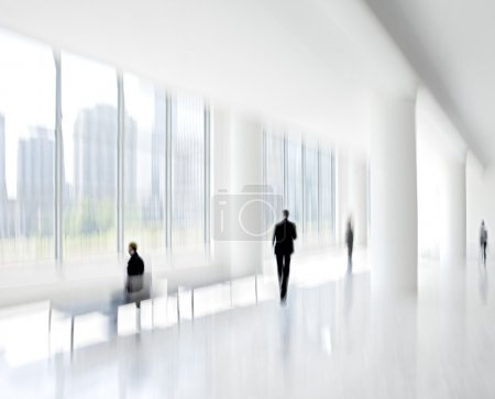 Photo for Abstract image of people in the lobby of a modern business center with a blurred background - Royalty Free Image