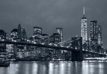 Photo for Panoramic view new york city manhattan downtown skyline at night with skyscrapers and brooklyn bridge - Royalty Free Image