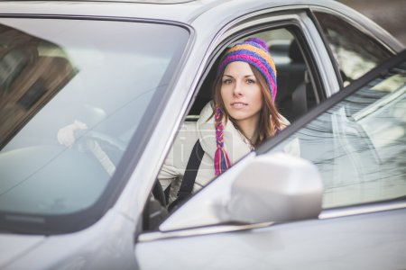 Young woman in a rental car