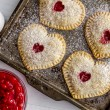 Heart shaped cherry hand pies dusted with sugar si...