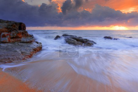 Sunrise with wave at Kemasek Beach taken with Slow Shutter