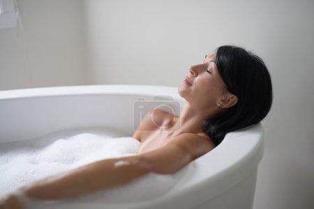 mature woman in a bathtub