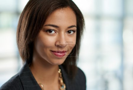 Horizontal headshot of an attractive african american business woman shot with shallow depth field.